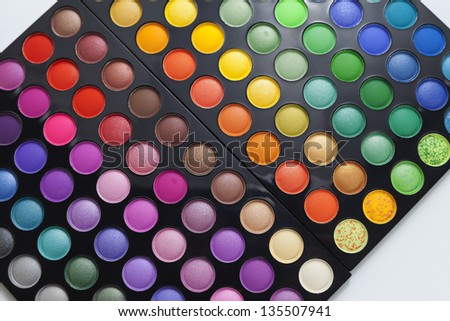 Set of professional colorful eyeshadow palette in close-up view. - stock photo