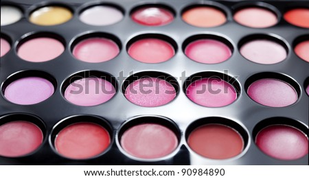 Set of professional colorful lipstick palette in close-up view.