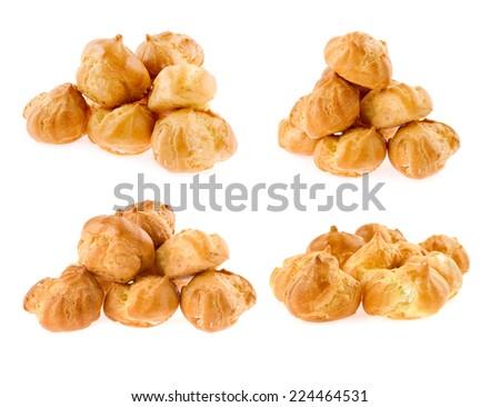 set of profiteroles pile isolated - stock photo