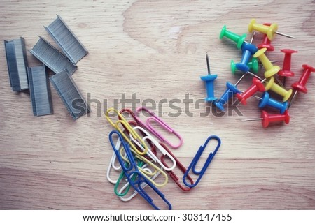 Set of push pins with paper clips and staples  - stock photo