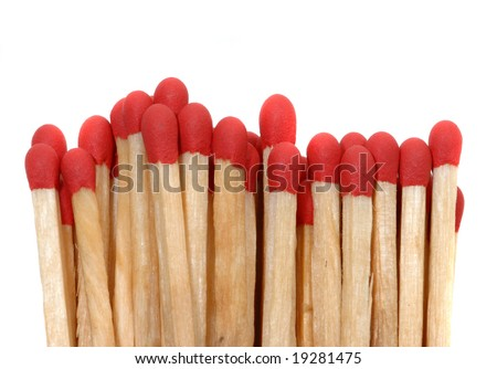 Set of red matches close up on white background - stock photo
