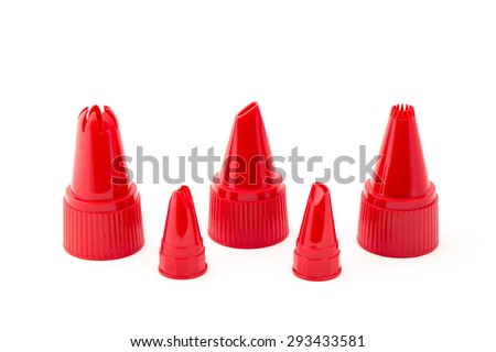 Set of red nozzles for decorate pastry. - stock photo