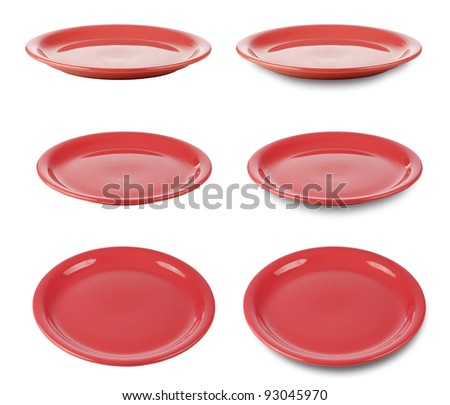Set of red round plates or dishes isolated on white with clipping path included - stock photo