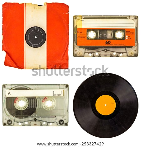 Set of retro compact cassettes and vinyl record albums isolated on a white background - stock photo