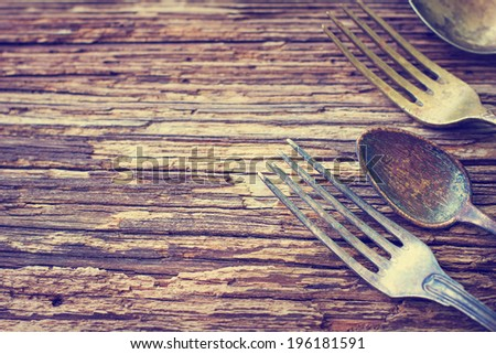 Set of retro forks, spoons  on wooden table - stock photo