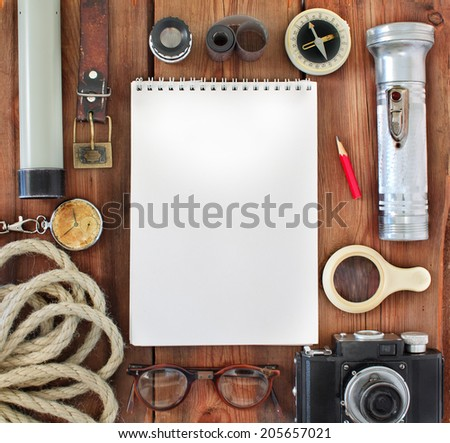 Set of retro items for tourists and travelers on a wooden background - stock photo