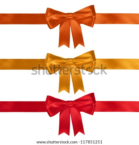 Set of ribbon bows - red, yellow, orange on white background. Clipping path for each bow included. - stock photo