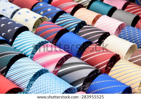 set of rolled up neck ties - stock photo