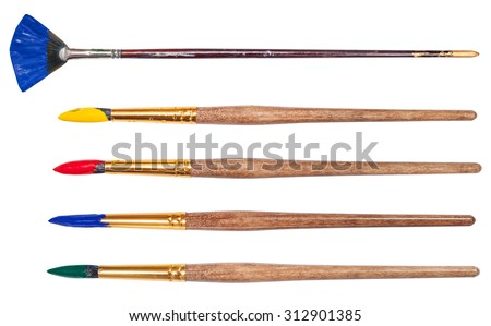 set of round artistic paintbrushes with painted tips isolated on white background - stock photo
