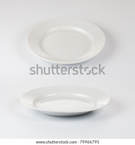 Set of round plates or dishes on white background - stock photo