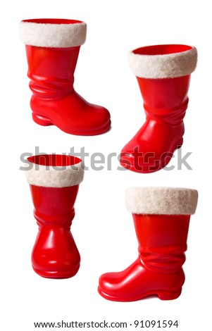 Set of Santa Claus boots isolated on white background with clipping path - stock photo