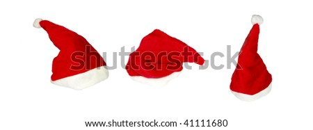 Set of Santas caps on white background - stock photo