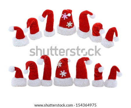 Set of Santas red hats isolated on white background - stock photo