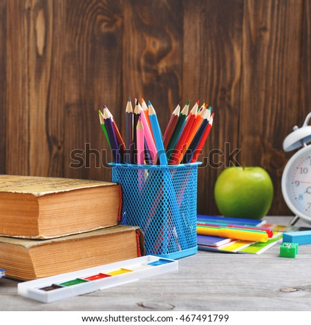 Set of school supplies on wooden table close up