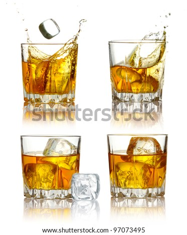 Set of scotch whiskey glasses with splash and ice isolated on a white - stock photo