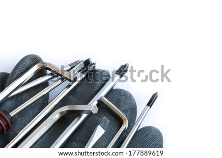 Set of screwdrivers and glove over a white background with space for text