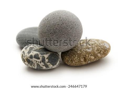 Set of sea stones on white background - stock photo