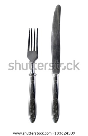 Set of silver dinner knife and fork isolated over white - stock photo
