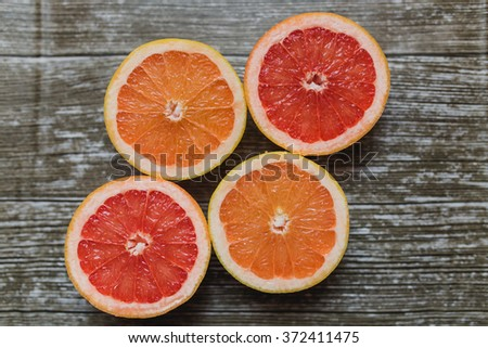 Set of sliced grapefruit isolated on a deep black background - stock photo