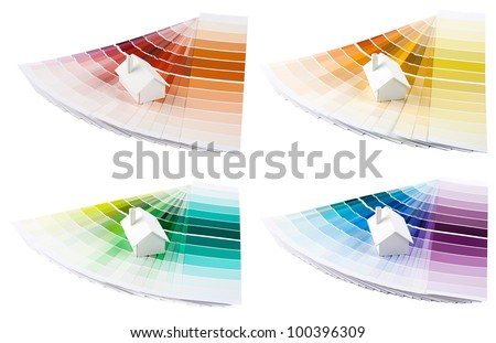 Set of small simple white model house on a color palette with different colors of spectrum. - stock photo