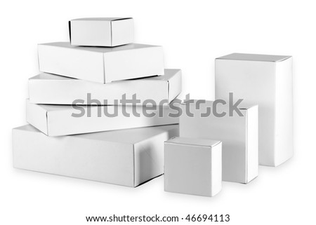 Set of small white  cardboard boxes of the different size. Isolated on white with clipping patch. - stock photo