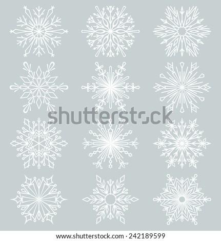 Set of snowflakes. White  snowflakes on a blue background. Beautiful winter ornament. Snowflake icons. - stock photo