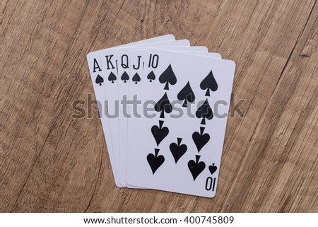 Set of Spade suit playing cards on wooden desk - stock photo