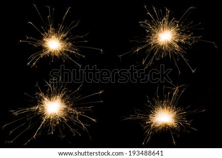 Set of sparkler little firework on black background. Use for Christmas and New year and other celebration. - stock photo