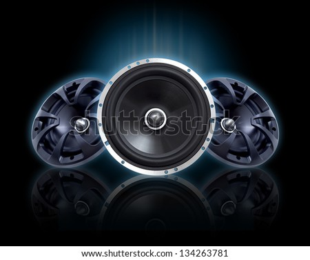 Set of speakers on black background - stock photo