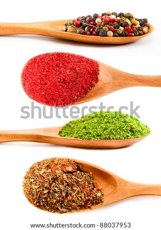 set of spices in a wooden spoons isolated on a white background - stock photo
