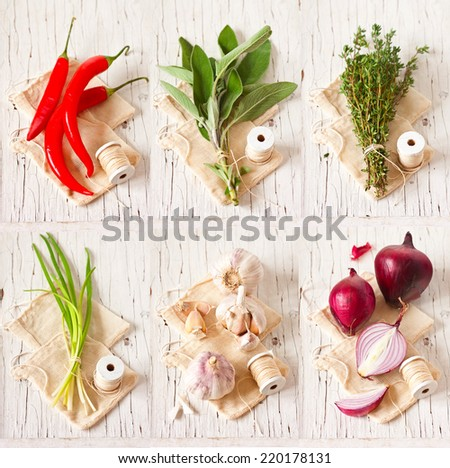 Set of spicy herbs and vegetables on an old wooden board.