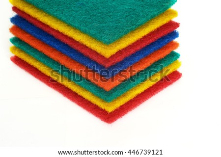 Set of sponges of various color on white background - stock photo