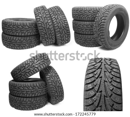 set of stack of four new black tyres for winter car on white background  - stock photo