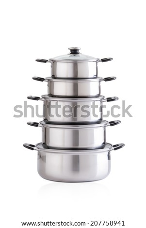 Set of stainless pots with glass lids isolated on white - stock photo