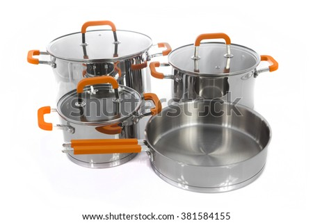 Set of stainless pots with lids - stock photo