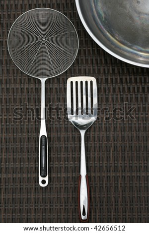 Set of stainless steel cooking utensils kitchenware and wok - stock photo