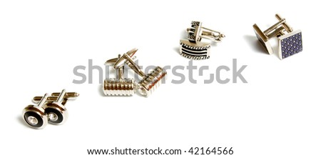 set of stainless steel cufflinks isolated on white background - stock photo