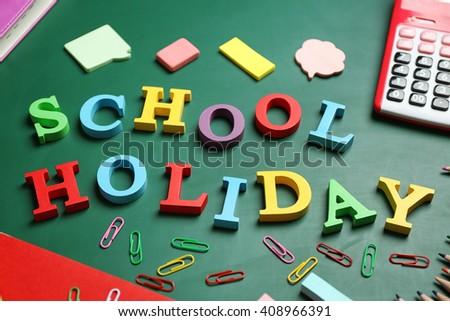 Set of stationery with alphabet on blackboard - stock photo
