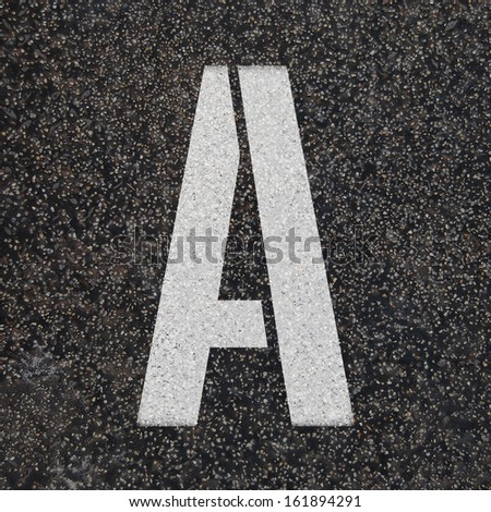 Set of Stencil alphabet letters painted on asphalt road black floor - check my portfolio for other letters