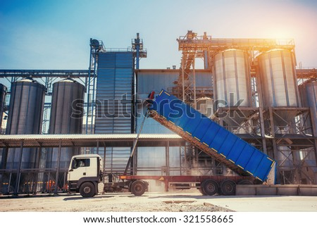 Set of storage tanks cultivated agricultural crops processing plant - stock photo