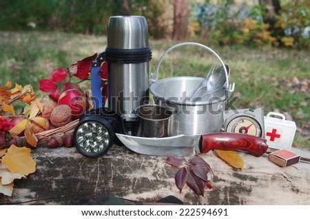 Set of survival equipment in the forest. - stock photo