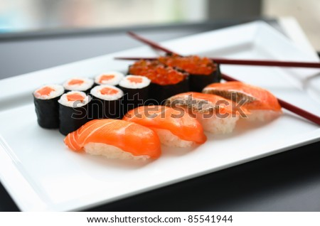 Set of sushi and rolls with a salmon - stock photo