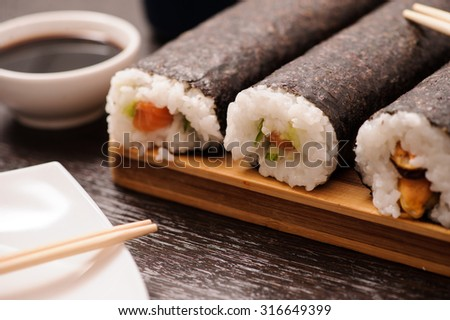 set of sushi on the wooden table - stock photo