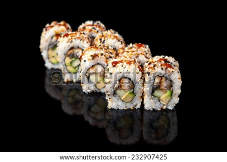 set of sushi rolls with eel on a black background - stock photo