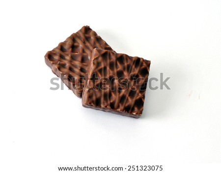 set of sweets of white and dark chocolate with different shapes and textures  - stock photo