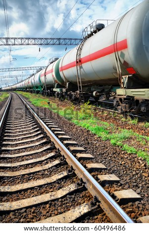 Set of tanks with oil transport by rail - stock photo