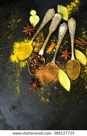 Set of  teaspoons with spices on black background - stock photo