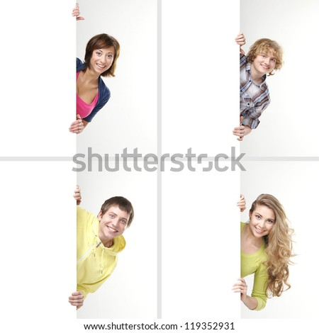 Set of teenagers with a giant, blank, white billboard - stock photo