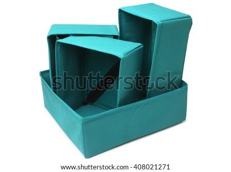 Set of textile storage boxes on white background - stock photo
