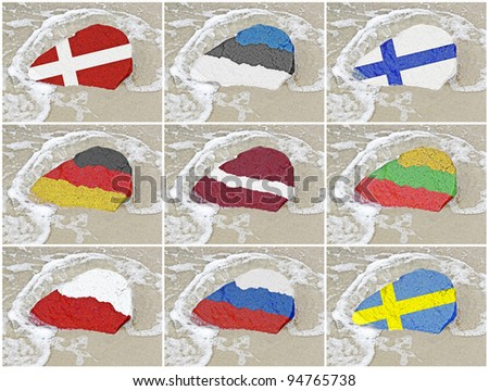 Set of the Flags of the nine states bordering on the Baltic sea - Denmark, Estonia, Finland, Germany, Latvia, Lithuania, Poland, Russia and Sweden - on a stone on Baltic Sea beach - stock photo